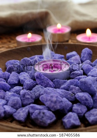 Decorative stones and candles - stock photo