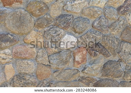 decorative stones embedded in wall