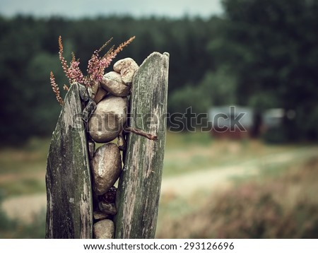 Decorative trail marker made of stones, wood and heather - stock photo