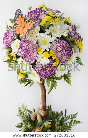decorative tree with flowers and a butterfly