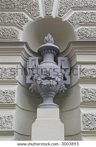 Decorative Vase Standing in Niche By Building Wall - stock photo