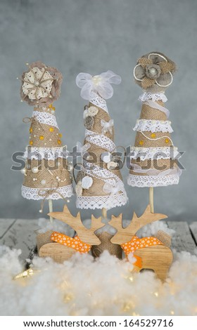 decorative vintage Christmas tree in the snow - stock photo