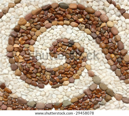 Decorative wall made of brown and white round stones - stock photo