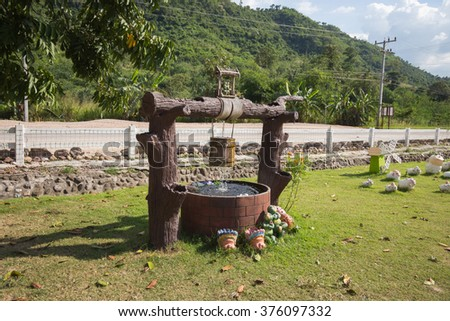 Decorative well Park with various species of animals far away from city noise - stock photo