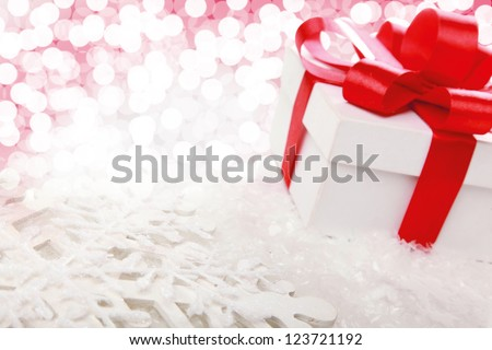 Decorative white gift box with a red bow  a background bokeh - stock photo