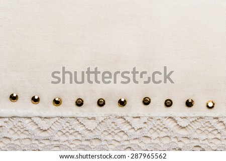 decorative white lace cloth with metal studs background for wedding, invitation or greeting card. - stock photo