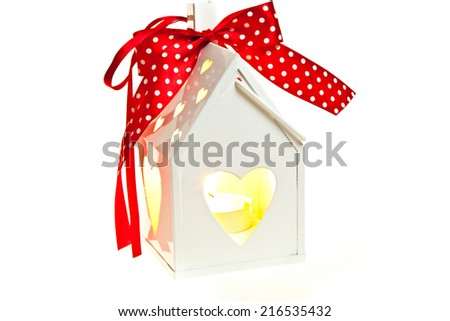 Decorative white metal lantern with a heart cutout for Valentines or Christmas - stock photo