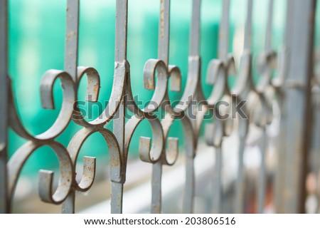 Decorative wrought iron security - stock photo