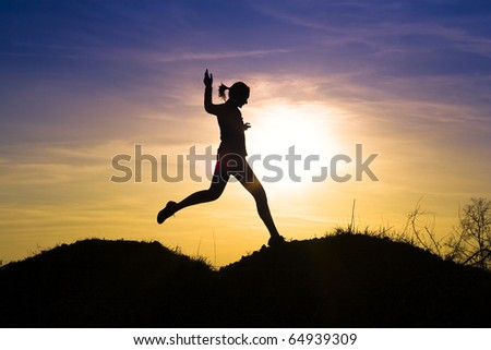 Decorative young girl running outdoors. - stock photo