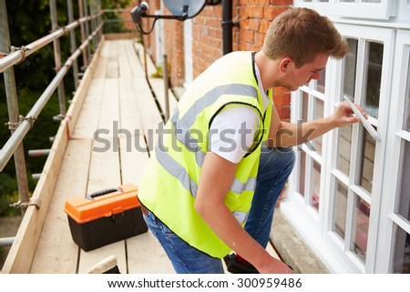Decorator On Scaffolding Painting Exterior House WindowsExterior House Painting Stock Images  Royalty Free Images  . Painting Exterior House Windows. Home Design Ideas