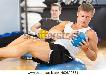 Dedicated men trains abdominal exercise for core strength - stock photo
