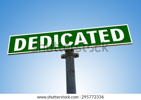 DEDICATED word on green road sign - stock photo