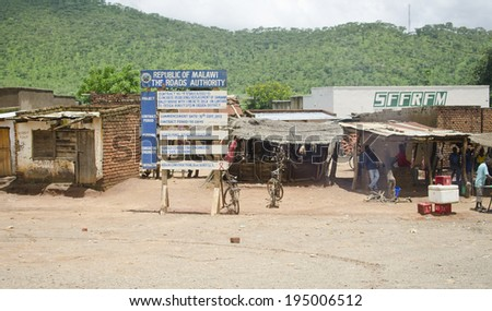 DEDZA, MALAWI - JANUARY 16: a street scene on January 16, 2014 in Dedza, Malawi. Dedza is the main township of Dedza District in the Central Region of Malawi.  - stock photo