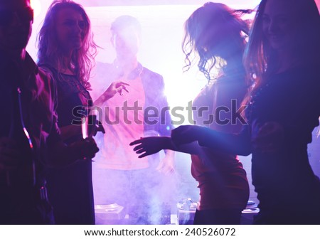 Deejay and dancing girls - stock photo
