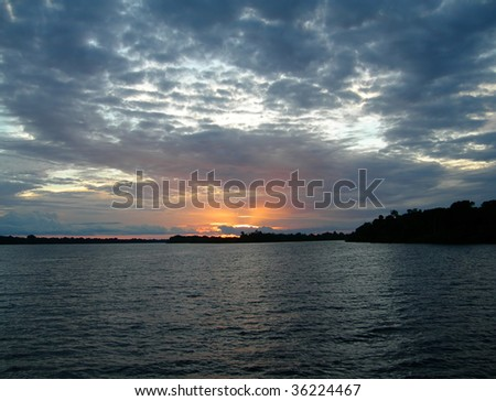 Deep blue sunset on the Rio Negro in the Amazon River basin, Brazil, South America - stock photo