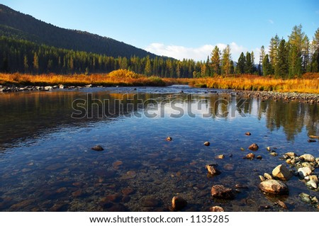 Deep blue water in river. Altay - stock photo