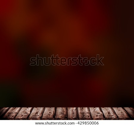 Deep coffee blur background. Brown wooden boards to form a flat surface at the bottom. Dark chocolate matte texture behind. 3D illustration