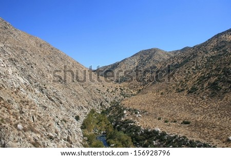 Deep Creek cuts a path through the mountains of the California desert - stock photo