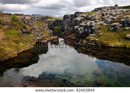 Deep fissure Flosagja at Thingvellir National Park, a fissure in the earth's crust where the european and american continental plates drift apart. - stock photo