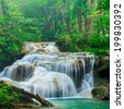 Deep forest waterfall at Erawan waterfall National Park Kanjanab - stock photo