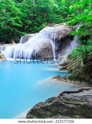 Deep forest waterfall at Erawan waterfall National Park Kanjanaburi Thailand - stock photo