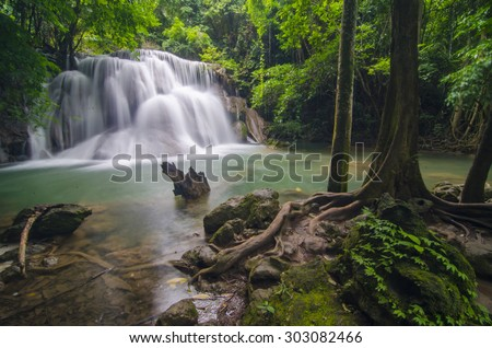 Deep forest waterfall at Erawan waterfall National Park Kanjanaburi Thailand - stock photo