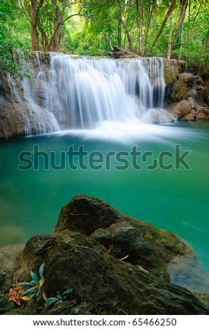 Deep forest Waterfall in Kanchanaburi, Thailand - stock photo