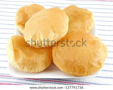 Deep fried bread prepared from wheat flour dough. - stock photo