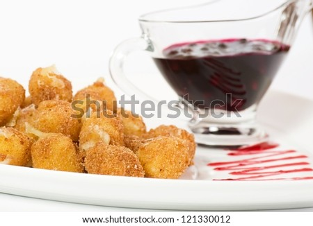 Deep fried cheese balls and sauce - stock photo