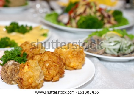 Deep fried cheese balls on the plate - stock photo