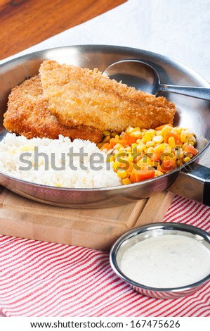 deep fried dory with corn and carrots and tartar sauce