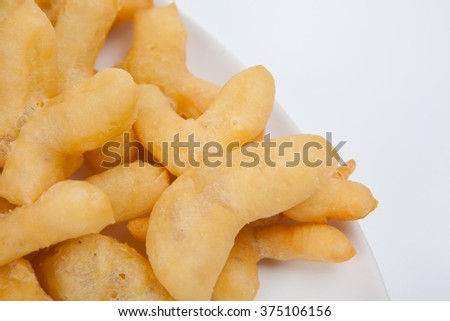 deep-fried dough stick (Patongko) on white paper background.