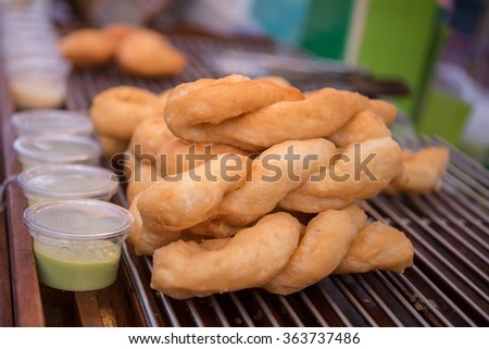 Deep-fried dough-stick, Snack and Dessert sell at market.selected focus