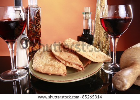 Deep fried empanadas, wine, and spices