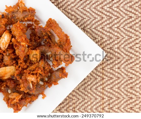 Deep fried pork tendons with delicious taste. - stock photo
