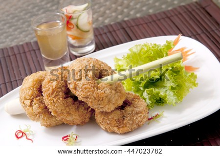 fried shrimp cakes deep fried shrimp cakes with wooden background deep ...