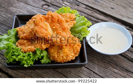 deep fried shrimp meat ball with sweet sauce on wooden table - stock photo