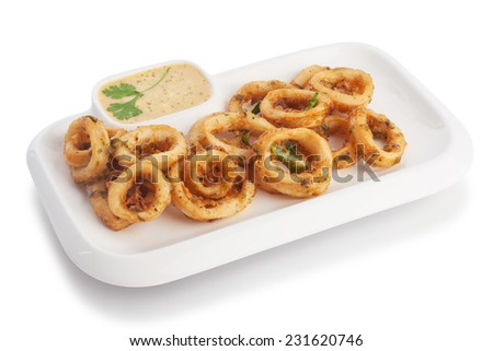 Deep fried squid & soft batter serve with tartar sauce, isolated on white.