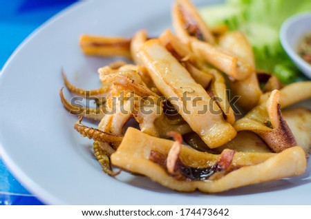 Deep fried squid with spicy sauce and lettuce - stock photo