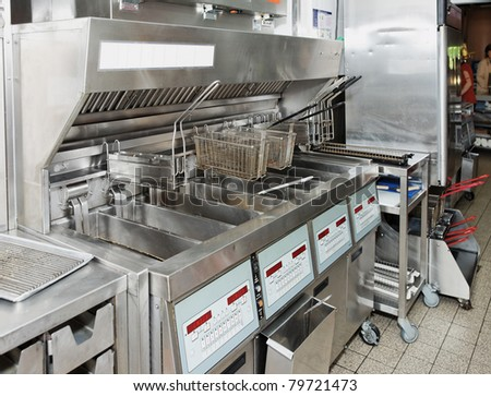 Deep fryer on restaurant kitchen - stock photo