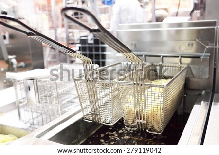 Deep fryer with french fries  - stock photo