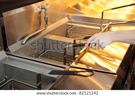 Deep fryer with oil - stock photo