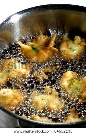 Deep-frying cod accras - stock photo