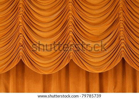 Deep gold stage curtains. - stock photo