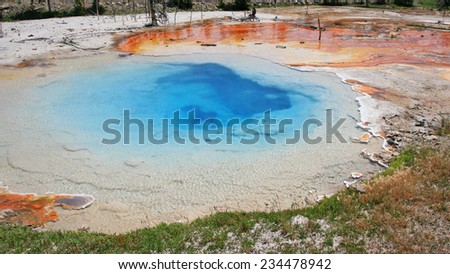 Deep green blue geyser pool in yellowstone national park in Wyoming, USA - stock photo