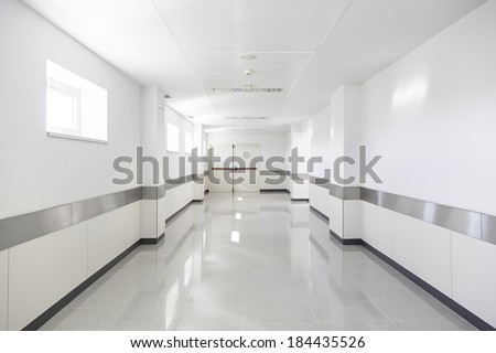 Deep hospital corridor, detail of a white corridor in a hospital, architecture and health - stock photo