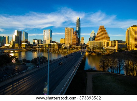 Deep Perspective Austin Texas South Congress Avenue Aerial Fly Hover Shot looking at State Capital Building. Sunset Glow hits the downtown Skyline Cityscape a dramatic Urban ATX shot.  - stock photo