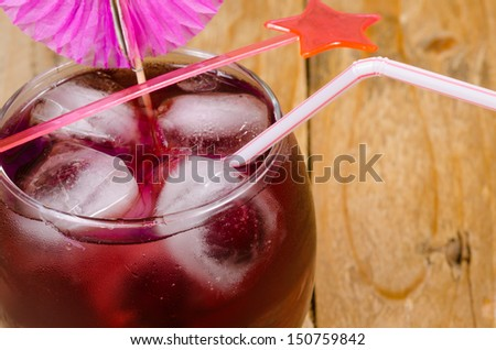 Deep red cocktail in a glass with plenty of ice