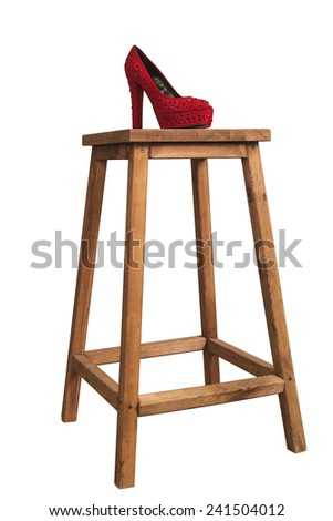 deep red high heel shoes on the wooden high stool - stock photo