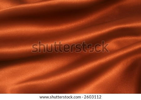 Deep, rich, chocolate couloured satin. Folded and flowing background - stock photo